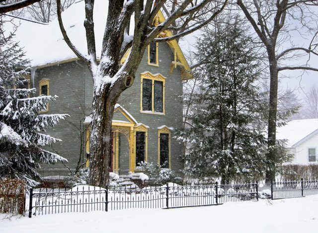 Gray house with yellow trim and snowfall, Chagrin Falls, December 13, 2010
